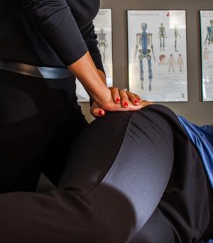A patient receives hip pain treatment
